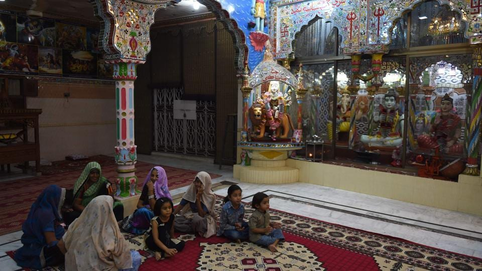"The HRCP describes Pakistani Hindus as feeling ""uneasy"" in their country, saying in its annual report that ""the migration of Hindus to India may soon turn into an exodus if the discrimination against them continues"". The HRCP, citing religious leaders, says the community's biggest problem is the ""forced conversion"" to Islam of women and girls, many of whom are abducted before being married off to Muslim men. (Rizwan tabassum / AFP)"