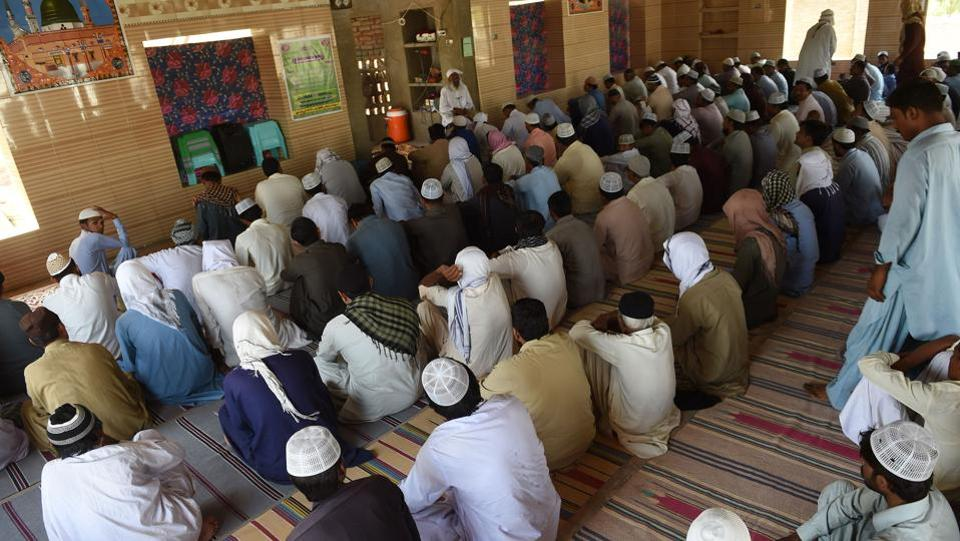 "The congregation listens to Allah Jurio. Although Chandar Kumar, a 24-year-old Hindu, sees no problems in the long-term among Mithi's residents, he said ""there are elements from outside who aspire to spread discrimination."" Exremist groups, such as the Jamaat-ud-Dawa, labelled a terrorist organisation by the UN, are accused of being active in the area. ""They want to end the unity,"" said Kumar. (Rizwan tabassum / AFP)"
