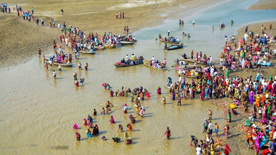 Devotees take a holy dip in the River Ganga on the first day of the Navratri festival in Allahabad, Uttar Pradesh. (PTI)
