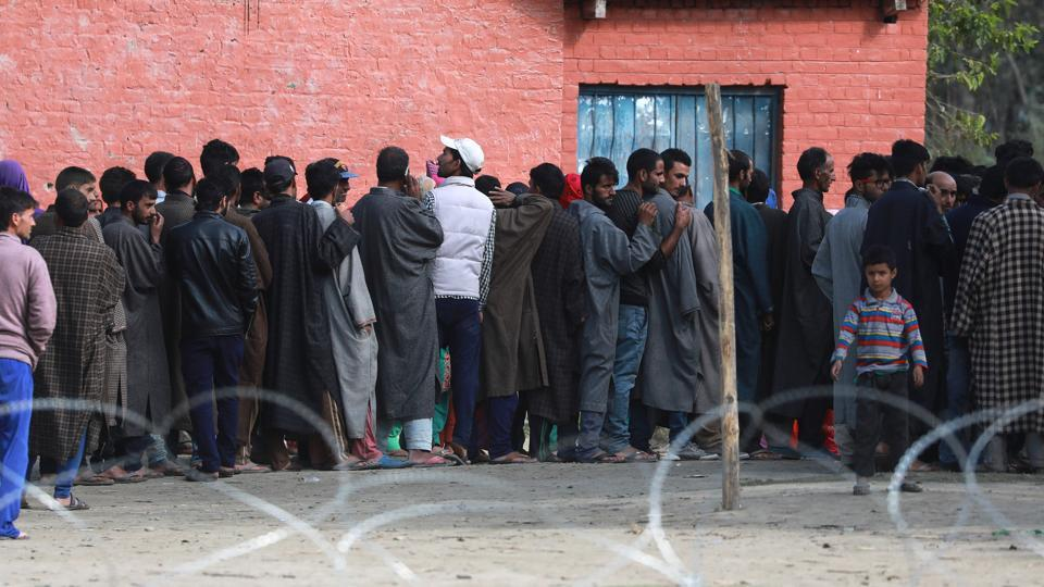 People stand in queue to cast their vote in Inderkoot, Bandipora district, Jammu and Kashmir. Amid shutdown called by separatists in poll-bound areas, more than 380 local bodies spread across 13 districts entered the second phase of the urban local bodies' elections in Jammu and Kashmir. The elections, to be held in four phases, began on October 8 and will end on October 16. (Waseem Andrabi / HT Photo)