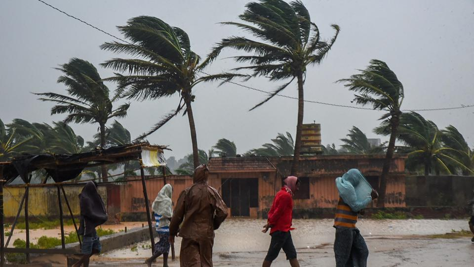 People make their way as Cyclone Titli makes landfall, starting with surface winds reaching speeds of 126 kmph at Gopalpur, in Odisha. Officials on Wednesday said that more than 300,000 people have been evacuated, operations suspended at the port of Paradip and many trains and flights cancelled. Eight people have died in Srikakulam and Vijayanagaram districts, reports ANI. (PTI)