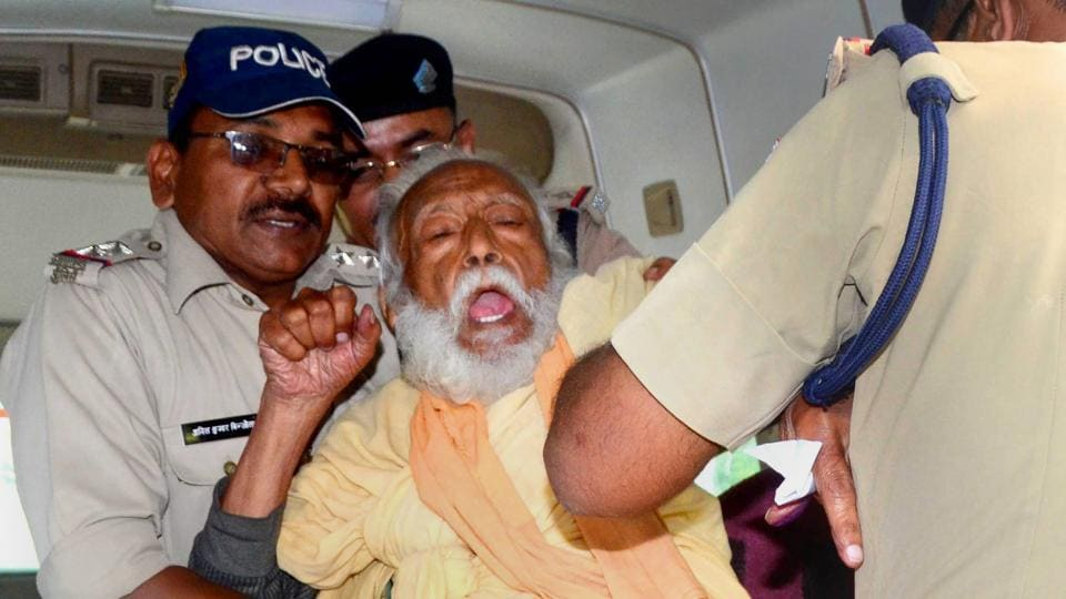 Environmentalist G D Agarwal, who had been fasting since June 22 for a clean River Ganga, being forcibly taken to the hospital after his health detriorated in Haridwar on Wednesday.