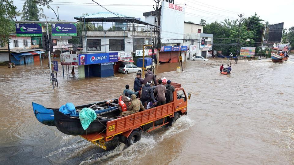 "A supply truck transports boats to flooded areas through waterlogged Aluva. Authorities in towns visited by Reuters, meanwhile, say that evacuation warnings were given. ""We made repeated microphone announcements about the opening of dam gates and asked people to move to safe places,"" said N.R. Jayaraj, deputy superintendent of police in Aluva, a town on the Periyar's banks that was badly hit by the floods. (Sivaram V / REUTERS File)"