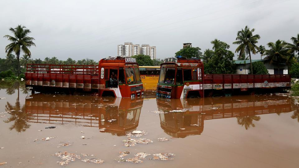 "Partially submerged trucks are surrounded by floodwaters, on the outskirts of Kochi. In court filings, Tamil Nadu said water released from the Mullaperiyar dam only constituted a small part of the spill from the much bigger Idukki reservoir. The IMD has also responded, saying it ""issued all necessary severe weather warnings"". KSEB's Pillai said forecasts failed to predict the intensity of the rain. (Sivaram V / REUTERS File)"