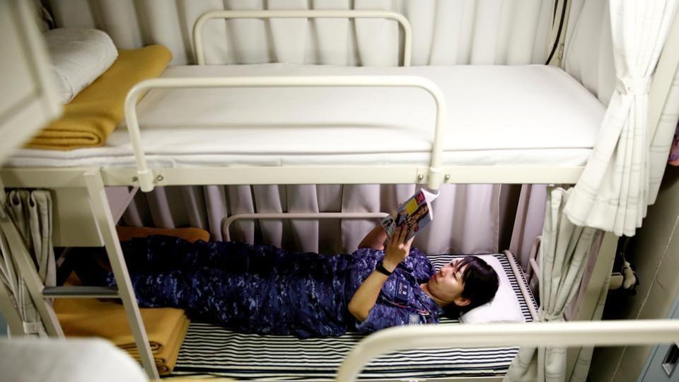 Miku Ihara, 22, a woman cadet on the Kaga, says she reads books