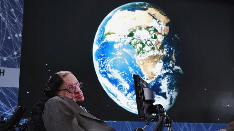 Physicist Stephen Hawking sits on stage during an announcement of the Breakthrough Starshot initiative with investor Yuri Milner in New York on April 12, 2016.