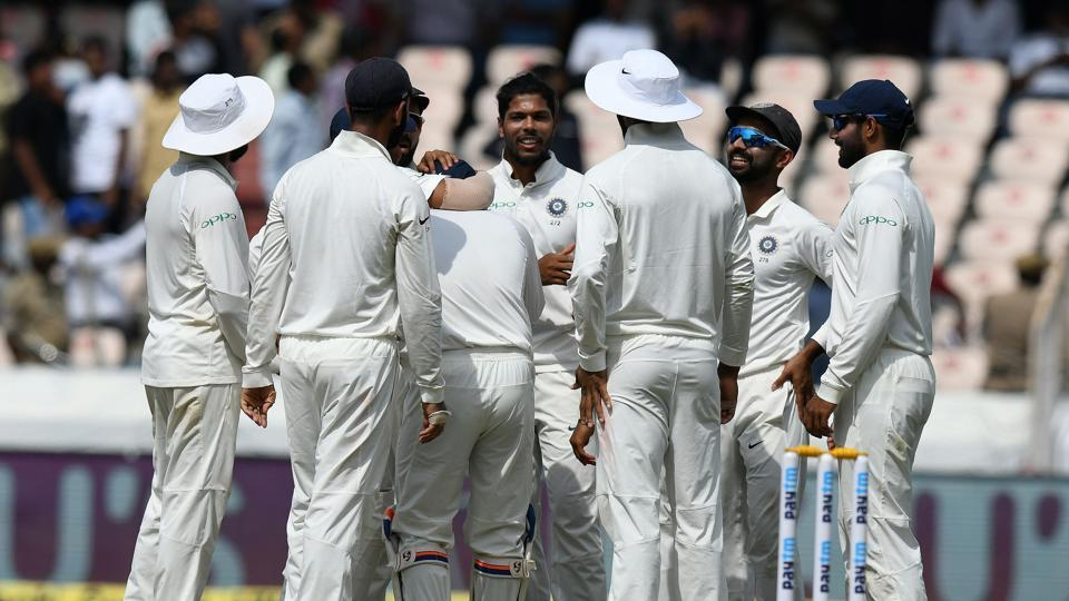 Indian cricketer Umesh Yadav (C) celebrates with his teammates for the wicket of West Indies cricketer Shane Dowrich during the first day's play of the second Test cricket match between India and West Indies at the Rajiv Gandhi International Cricket Stadium in Hyderabad. (AFP)
