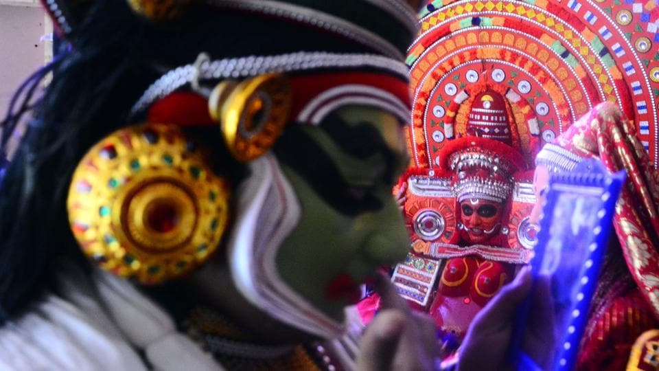 Artists get ready ahead of a Kathakali performance at Park Sheraton, organised by Kerala tourism in Pune, Maharashtra. (Shankar Narayan / HT Photo)