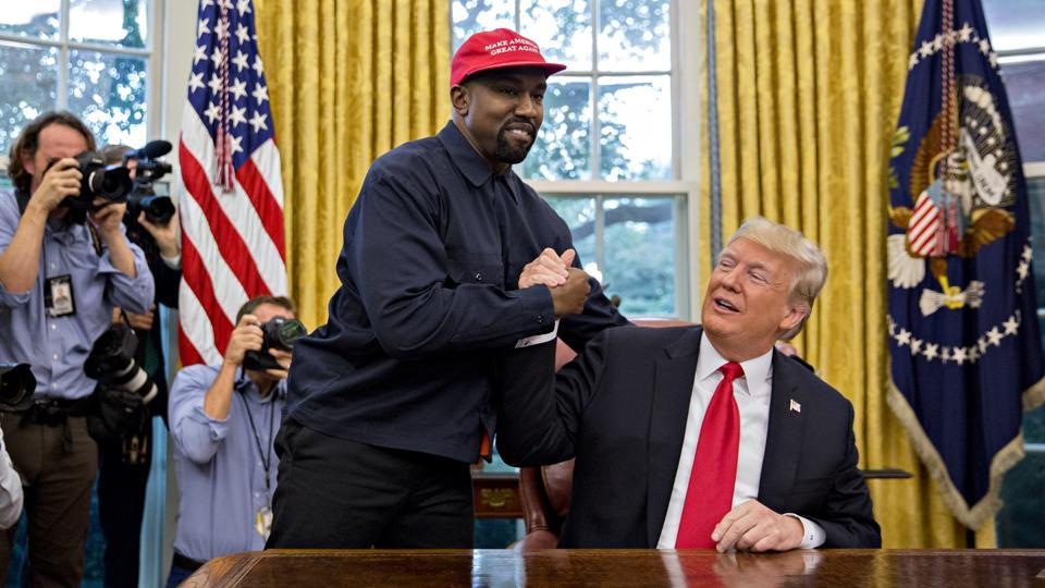 Rapper Kanye West shakes hands with US President Donald Trump during a meeting in the Oval Office of the White House in Washington, DC, on Thursday, Oct. 11, 2018.