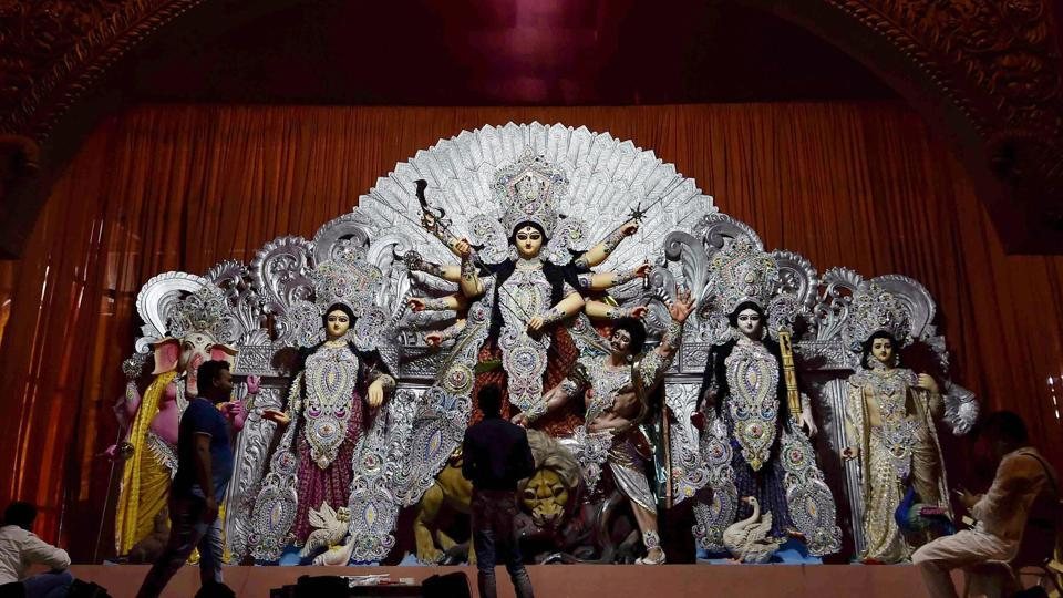 Artists give finishing touches to idols of deities at a Durga Puja pandal, in Kolkata, Thursday, Oct 11, 2018.  The SC has refused to stay Bengal government decision to grant Rs 10,000 each to 28,000 Durga Puja committees in the state.