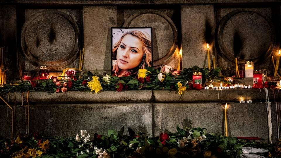 A portrait of slain Bulgarian television journalist Viktoria Marinova during in a candle-light vigil in the city of Rousse. Corruption-plagued EU member Bulgaria found itself under pressure to find the killer of the television journalist whose brutal murder at the weekend shocked the country and sparked international condemnation. (Dimitar Dilkoff / AFP)