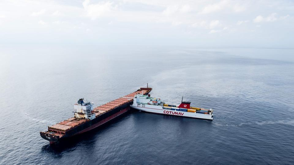 Two cargo ships after they collided off the Mediterranean island of Corsica. French and Italian ships raced o contain a spreading oil spill after the Tunisian freighter (front) rammed into the Cyprus-based CSL Virginia vessel that was anchored about 30 kilometres (20 miles) off the northern tip of the French island. (French Marine Nationale Handout / AFP)