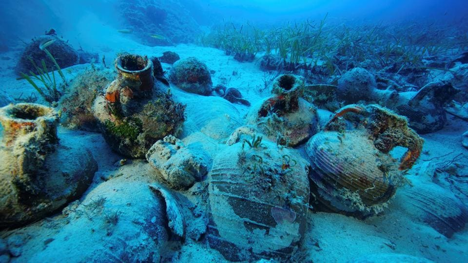 Amphorae are seen at the sea bottom at a shipwreck site on the island of Fournoi, Greece. Archaeologists in Greece have discovered at least 58 shipwrecks, many laden with antiquities, in what they say may be the largest concentration of ancient wrecks ever found in the Aegean and possibly the whole of the Mediterranean. (Vassilis Mentogiannis / Hellenic Ephorate of Underwater Antiquities / Handout via REUTERS)
