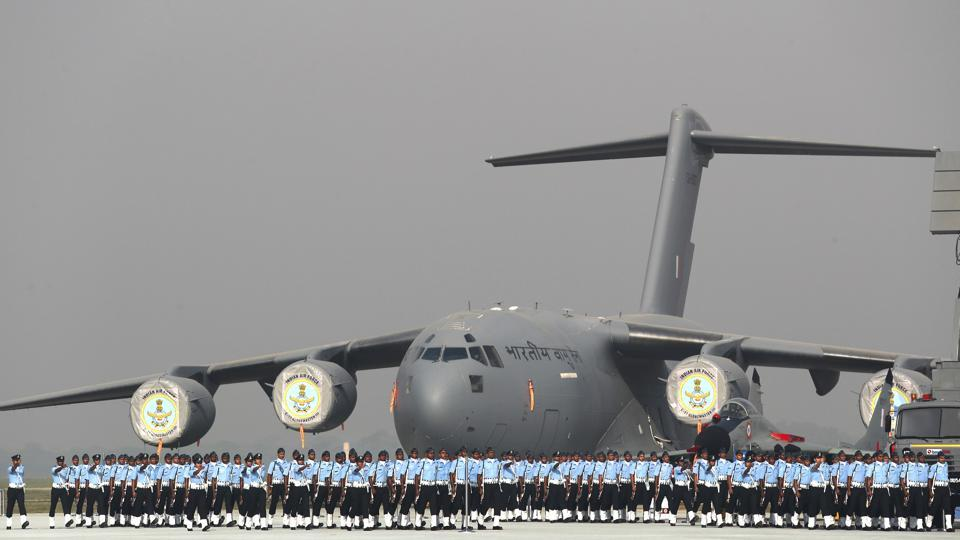 Indian Air Force soldiers march past a C-17 Globemaster military transport aircraft during the Indian Air Force day parade at Hindon air base on the outskirts of New Delhi. (Manish Swarup / AP)