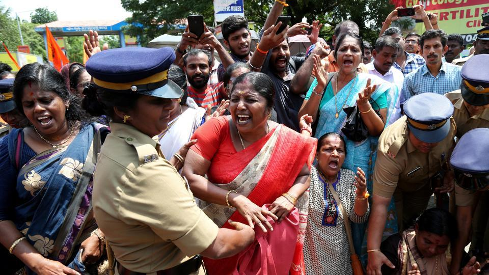 A woman reacts as she is detained by a police officer during a protest called by various Hindu organisations against the lifting of ban by Supreme Court that allowed entry of women of menstruating age to the Sabarimala temple, in Kochi, October 10