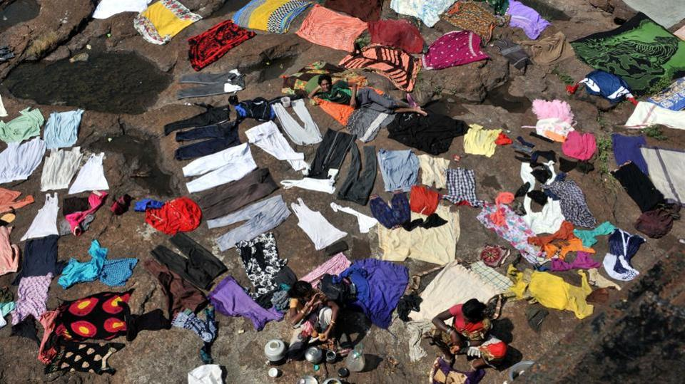 A view of washed clothes kept out to dry ahead of the Hindu festival Navratri, at Khadakwasla dam in Pune, Maharashtra. (HT Photo)
