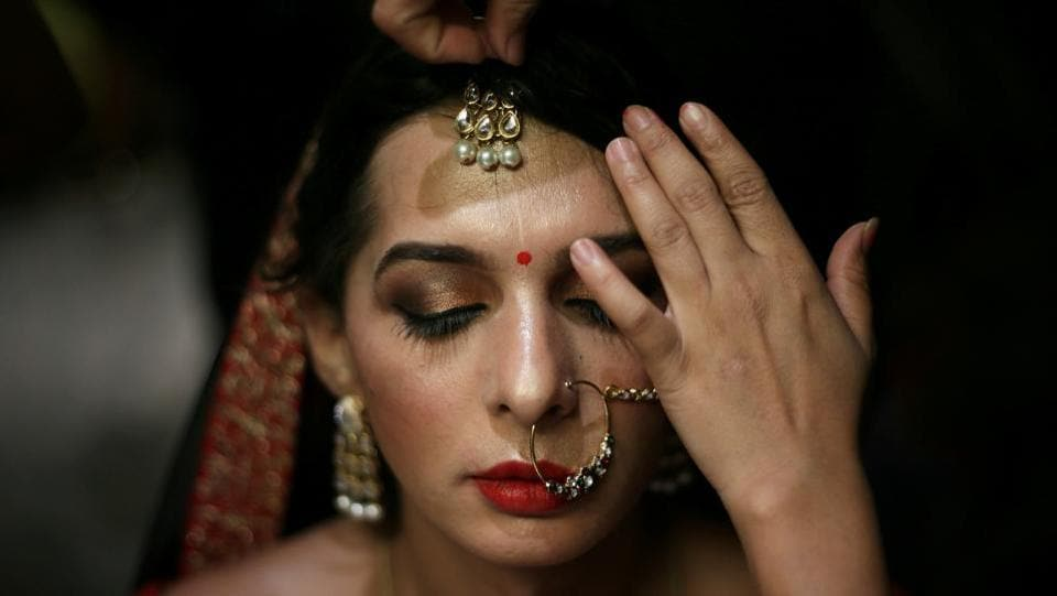 A contestant prepares backstage before the Miss Transqueen India 2018 transgender beauty pageant in Mumbai, Maharashtra. (Francis Mascarenhas / REUTERS)