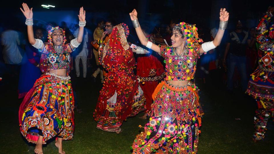 The Dandiya Raas dance originated as devotional Garba dances, were performed in honor of Goddess Durga. (SHANKAR NARAYAN/HT PHOTO)