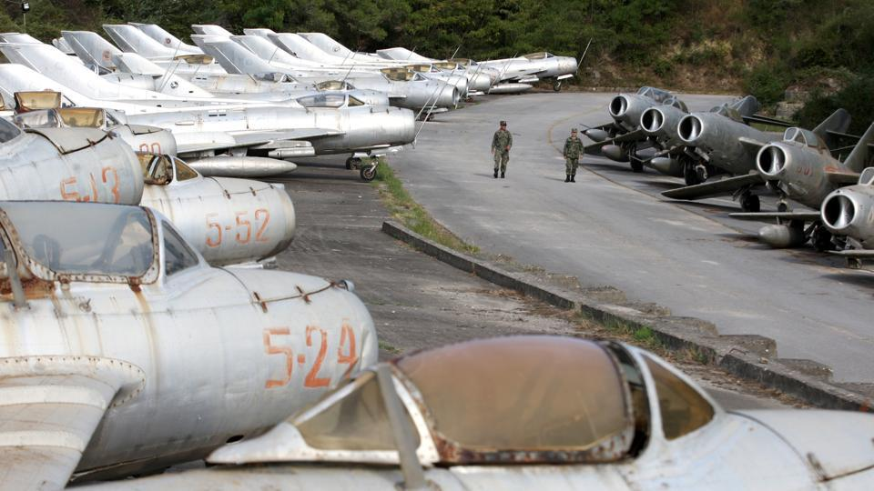 "Air Force members walk near dozens of MIG jet fighters at Kucova Air Base. ""The base is the first footprint of NATO in the Western Balkans as it will transform Kucova into the first NATO air base for the region,"" Defence Minister Olta Xhacka told Reuters. (Florion Goga / REUTERS)"