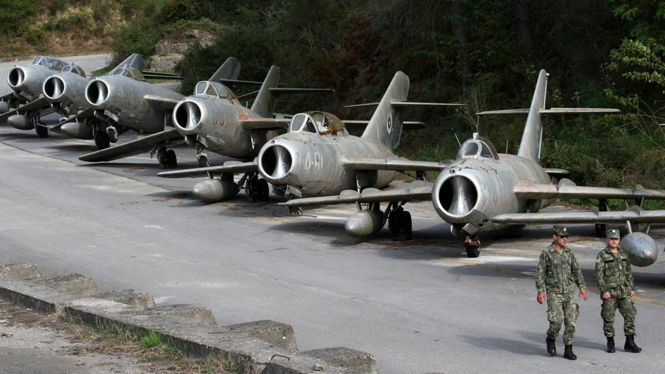 Albanian Air Force members walk near MiG-15 jet fighters at Kucova Air Base in Kucova, Albania. Long the graveyard of its once mighty air force, Albania's base at Kucova is set to become a NATO station - to the delight of its former airmen longing to hear the engines roar again. (Florion Goga / REUTERS)
