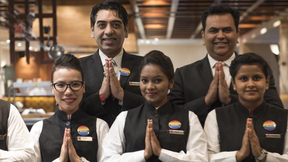 The staff of Lalit Group of Hotels in Mumbai wear badges showing their support for the LGBTQ community.