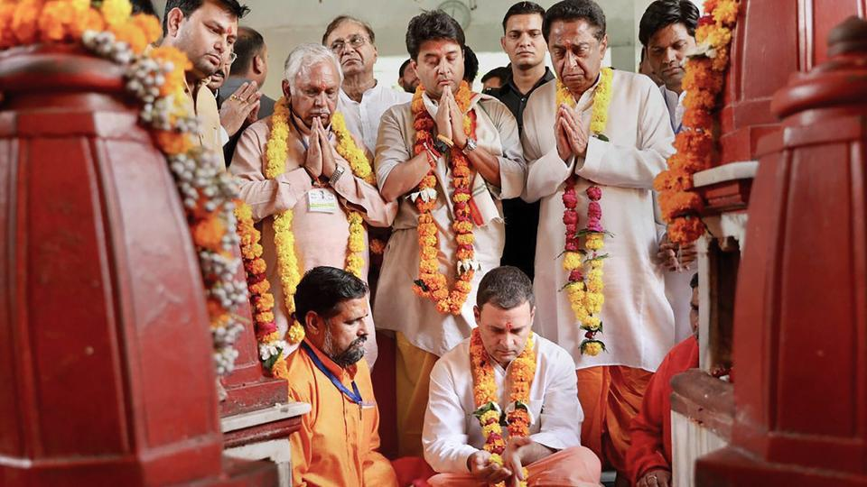 Congress President Rahul Gandhi along with state Congress president Kamal Nath and senior party leader Jyotiraditya Scindia offers prayers at Pitambara Peeth in Datia. During his two-day tour of poll-bound Madhya Pradesh, Gandhi will also be addressing a public meeting in Datia later in the day today. (PTI)