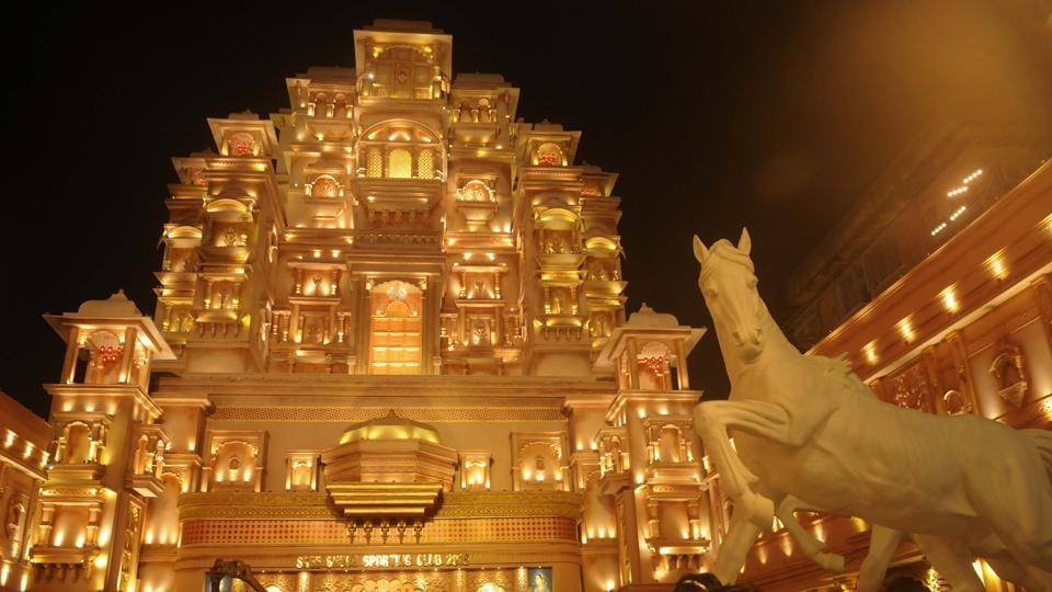 At Lake Town in North Kolkata, the Sree Bhumi Sporting Club has modelled this year's pandal on one of the year's most talked about subjects, that of the 7th century Padmavat's Chittorgarh palace. The goddess Durga here has been decked in jewellery worth more than Rs 10 crore. (Samir Jana / HT Photo)