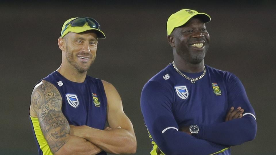 South Africa's captain Faf du Plessis and coach Ottis Gibson attend a practice session.