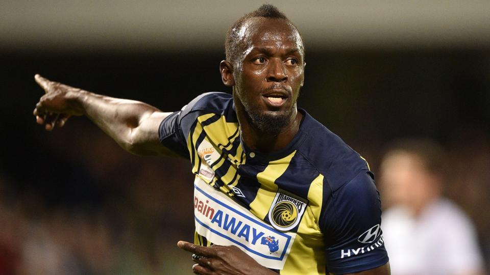 Usain Bolt celebrates scoring a goal for A-League football club Central Coast Mariners.