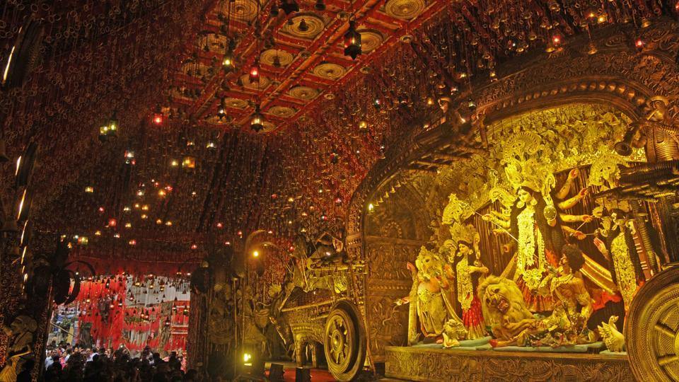 The 84th Durga Puja pandal of South Kolkata's Mudiali Club Sarbojanin is themed on Bengal's intricate and artistic folk art Dokar and Patachitra paintings. (Samir Jana / HT Photo)