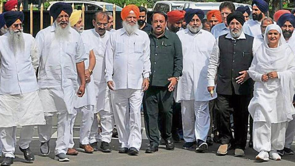 Shiromani Akali Dal leaders, led by party chief Sukhbir Singh Badal, coming out of the Punjab Raj Bhawan after submitting a memorandum to governor on Tuesday.