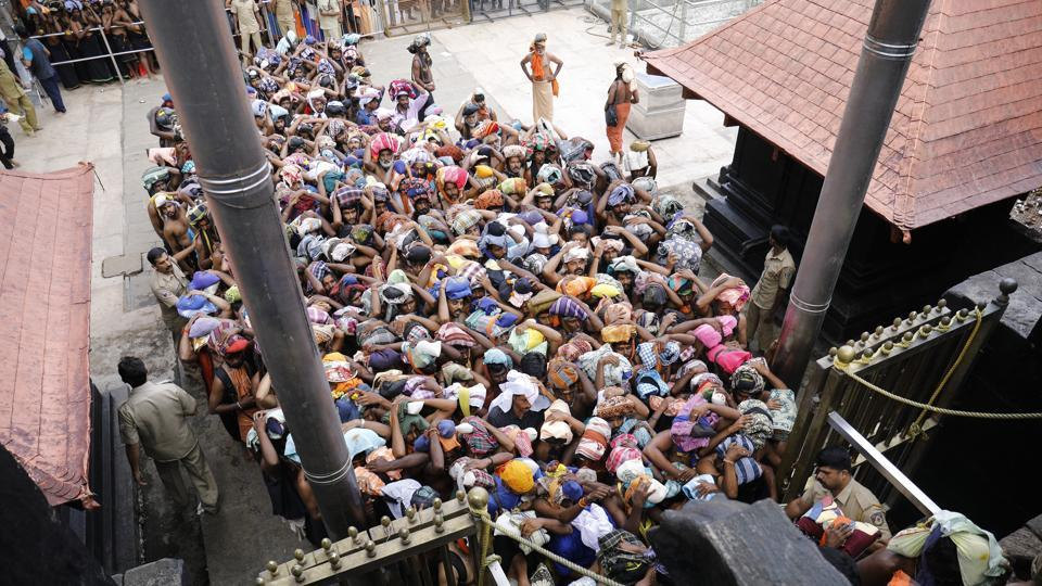 Devotees enter in the Lord Ayyappa temple as gates open in Sabarimala on October 17, 2018.
