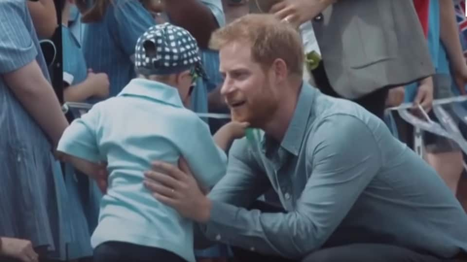 Adorable moment 5-year-old strokes Prince Harry's beard and steals