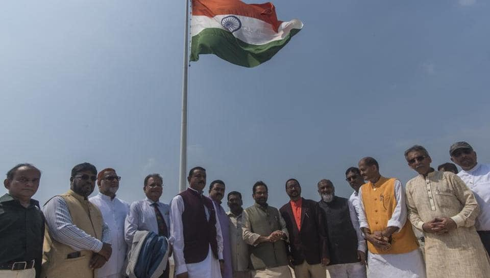 Minority affairs minister Mukhtar Abbas Naqvi (fourth from left) and other officials hoist the national flag at the Haj House in Mumbai, Wednesday, October 17, 2018.