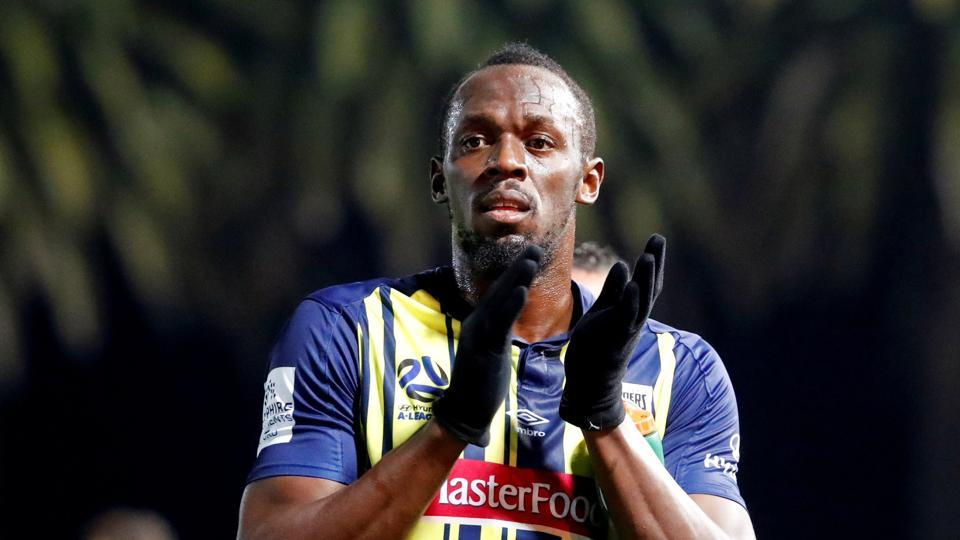 Central Coast Mariners' Usain Bolt applauds the fans after the match