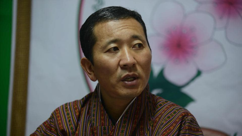 Dr Lotay Tshering, president of Bhutan party Druk Nyamrup Tshogpa (DNT), talks with the media after winning the elections.