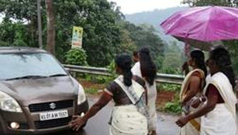Devotees stop a car to check if any women are headed towards the Sabarimala temple, Kerala, October 16