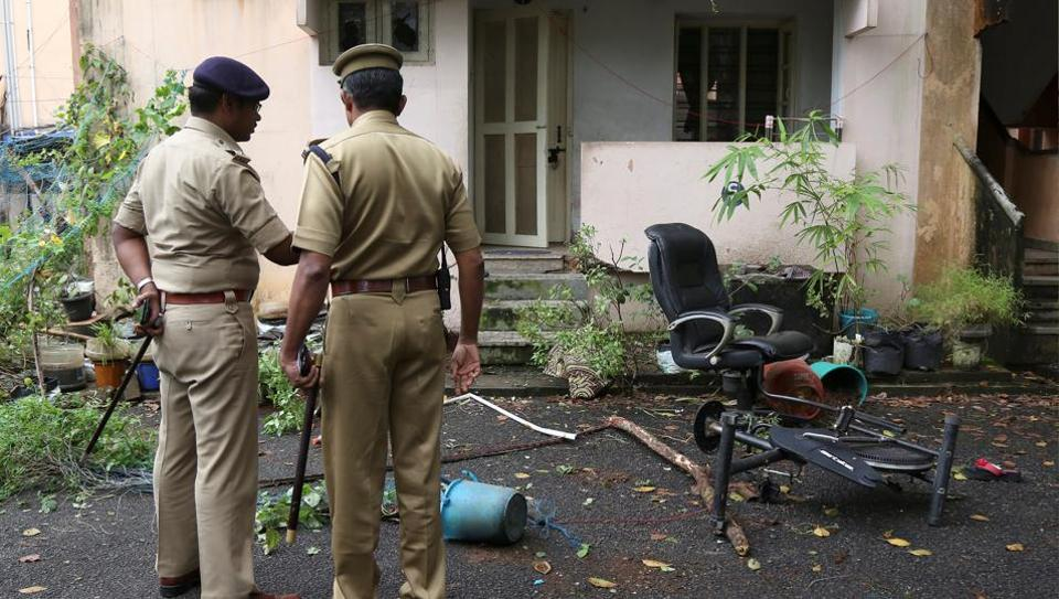 Police officers stand outside the ransacked house of Rehana Fathima, who made an attempt to enter Sabarimala temple which traditionally bars the entry of women of menstrual age, in Kochi, on October 19, 2018.