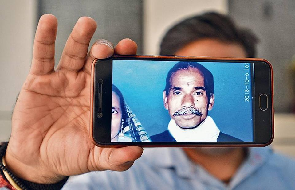 A man shows the photograph of his grandfather who was suffering from Alzheimer's disease and has been missing for years.
