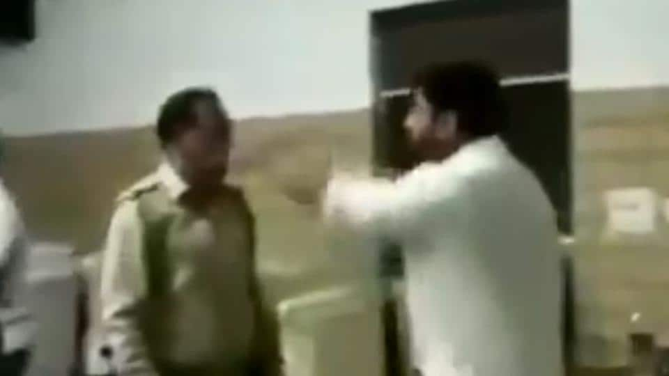 A screengrab from a video shows BJP municipal councillor Manish Panwar arguing with a police officer in his restaurant before beating him up, in Meerut.