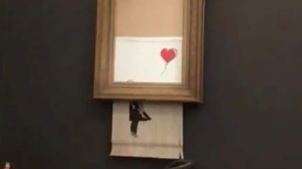 "Banksy's painting ""Girl with Red Balloon"" is seen shredded after its sale at Sotheby auction in London, Britain October 5, 2018."