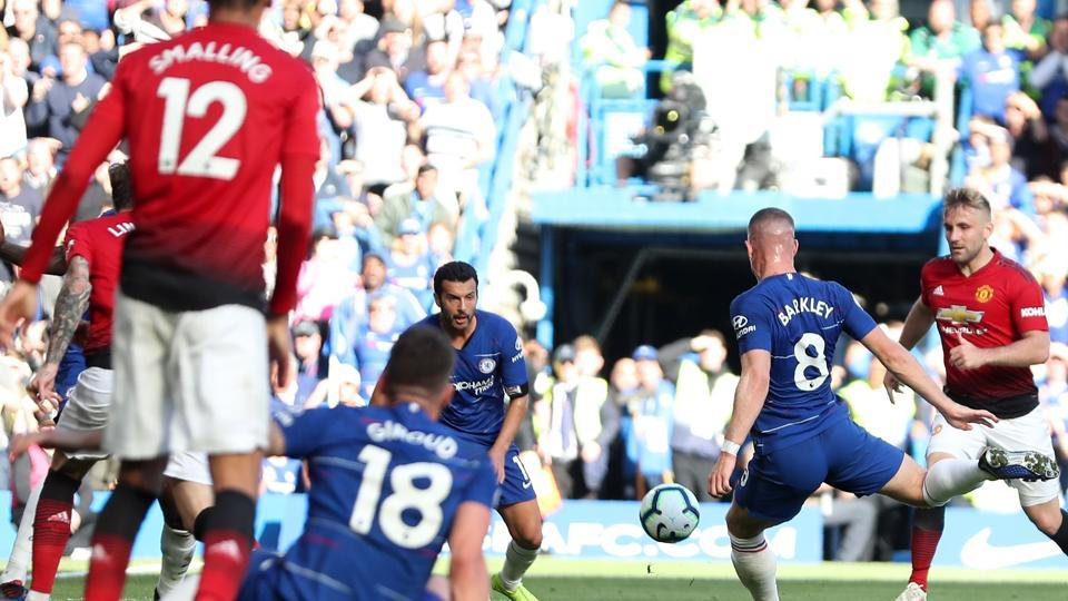 Chelsea's English midfielder Ross Barkley (2nd R) shoots to score their second goal during the English Premier League football match between Chelsea and Manchester United at Stamford Bridge.