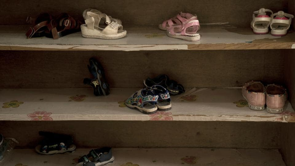 "Shoes are stacked on shelves at the Salhiya Orphanage. One 5-year-old boy, she said, refused to shake her hand because she's a woman. A 7-year-old boy asked for a knife to show a friend how to behead a doll. ""We have slowly changed their ideas and the way they think,"" al-Chalabi said. (Maya Alleruzzo / AP)"