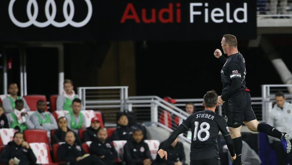 D.C. United forward Wayne Rooney (9) celebrates after scoring a goal on a free kick against Toronto FC in the first half at Audi Field.