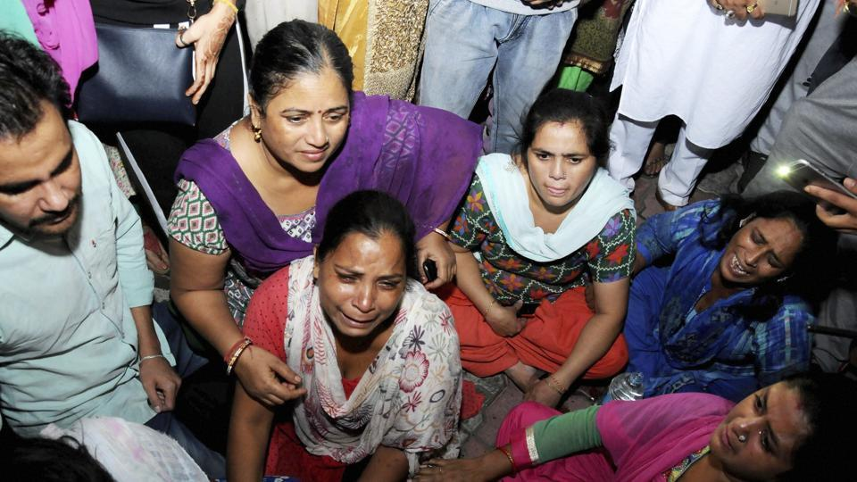 Relatives grieve for the victims of the Amritsar train accident.