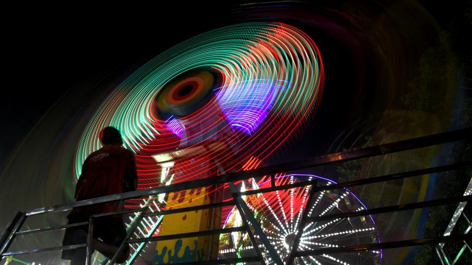 A Ferris wheel lit up during the Dussehra fair at Ramlila ground near Red Fort in New Delhi. (Amal KS / HT Photo)