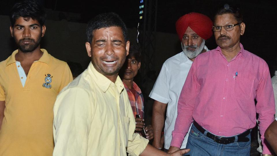 People mourn the death of their relatives in a train accident in Amritsar on Friday.