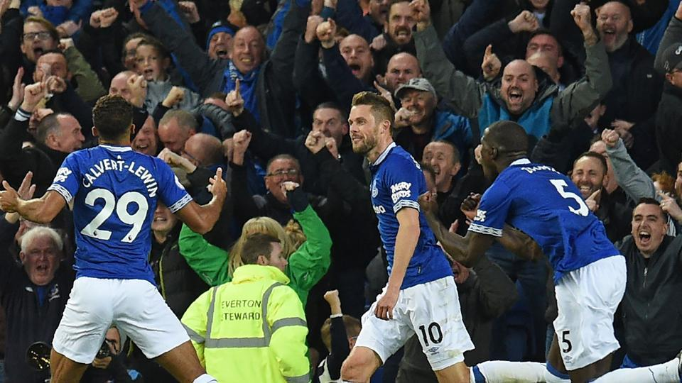 Everton's English striker Dominic Calvert-Lewin (L) celebrates with teammates after scoring the opening goal of the English Premier League football match between Everton and Crystal Palace.