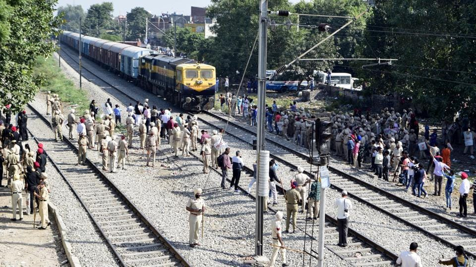 The eyewitnesses of Friday's train tragedy in Amritsar have accused the loco pilot of lying to police and railway authorities that he did not stop the train because the Dussehra revellers at the spot of the accident had started pelting stones. At least 61 people were killed and 74 injured in the accident. (Sameer Sehgal / HT Photo)