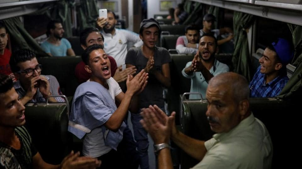 People sing in a train as they travel through the outskirts of Damascus towards the recently opened international fair. Although, the risk of being hit by bullets or shellfire near the capital has now ended, but conditions in central Damascus, with its relaxed nightlife and bustling business district, seem a world away from the hardship of eastern Ghouta. (Marko Djurica / REUTERS)